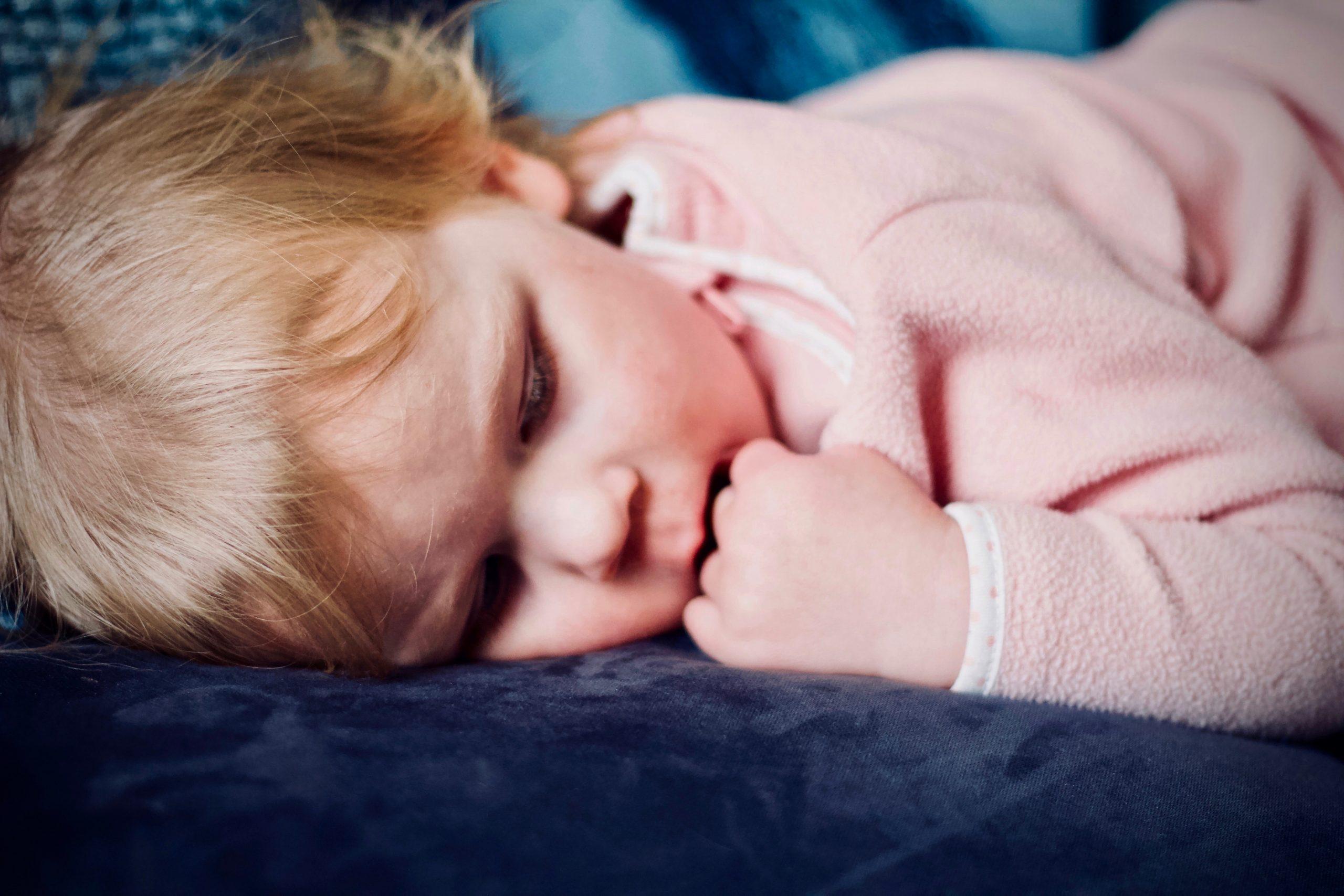 Sick child sleeping on sofa